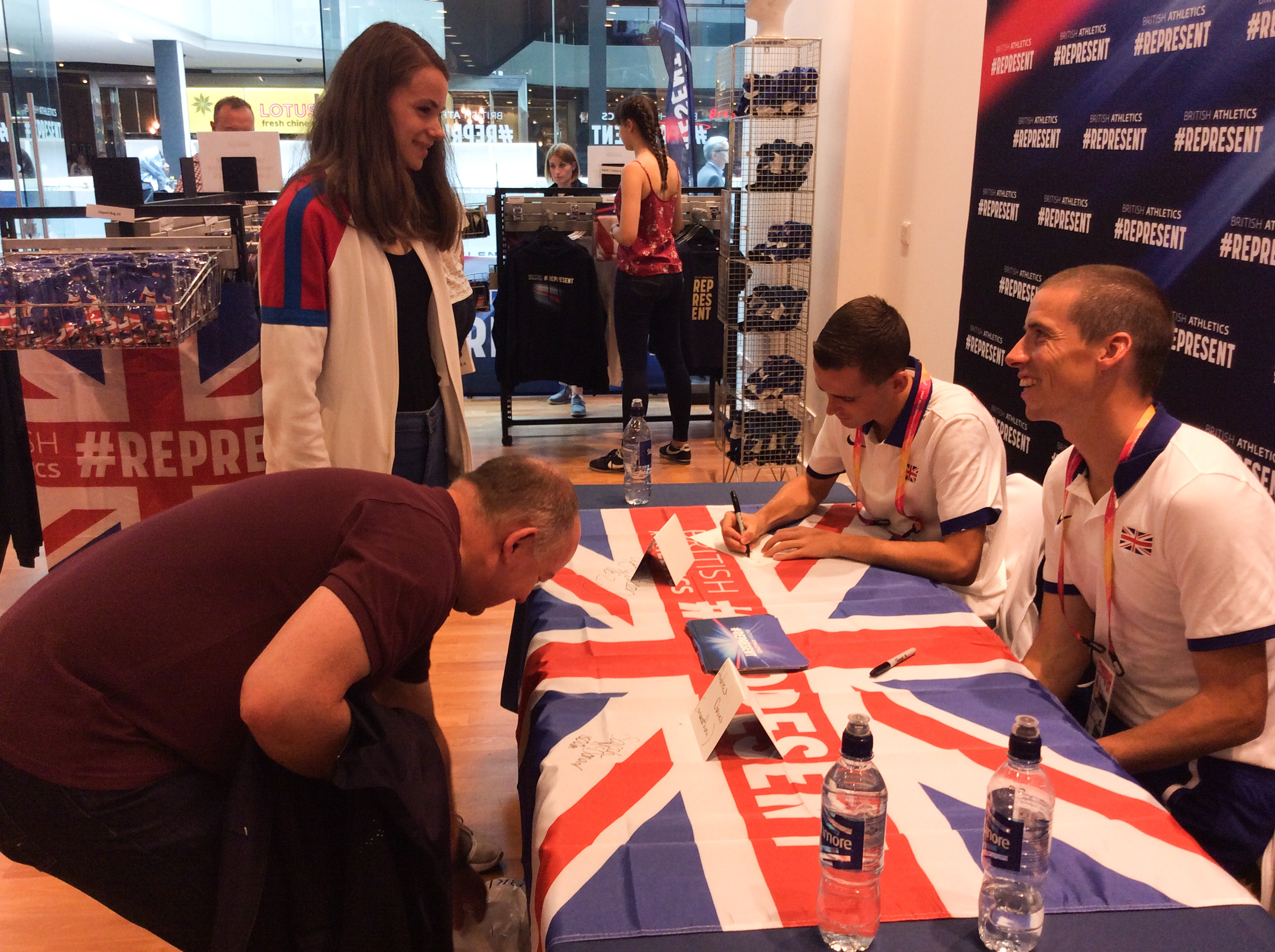 Andrew Davies and fan at the British Athletics Shop